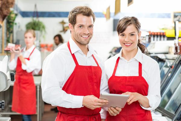 smiling male and female employees